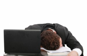 sleeping man at desk